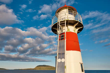 Red and white picturesque lighthouse in Faroe islands, Torshavn harbor 版權商用圖片