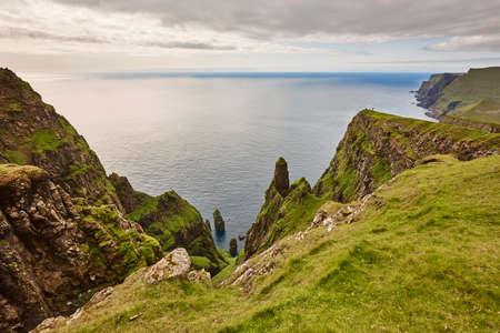 Suduroy island dramatic coastline and cliffs in Faroe archipelago. Denmark