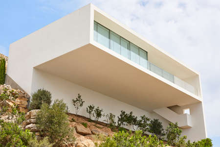 Modern building facade with balcony in white Color. Spain Stock Photo