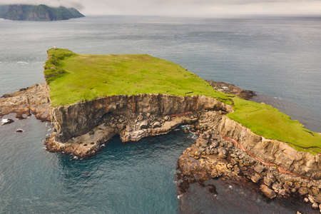 Faroe islands dramatic coastline viewed from helicopter. Vagar area Stock Photo