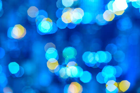 Defocused blue lights abstract background. Bokeh effect. City lights. Copyspace