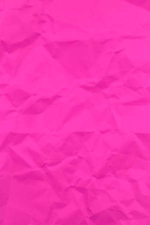 Textured crumpled pink paper background. Vertical Stock Photo