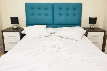 Bedroom with unmade double bed. Indoor nobody. Horizontal Stock Photo