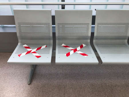 Social distancing. Covid-19 virus protection. Hospital waiting area bench. Hygiene