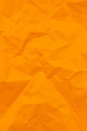 Textured crumpled orange paper background. Vertical