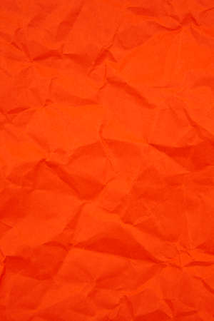 Textured crumpled red paper background. Vertical
