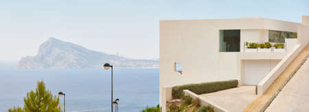 White geometric building facade in spanish coastline. Mediterranean sea. Spain