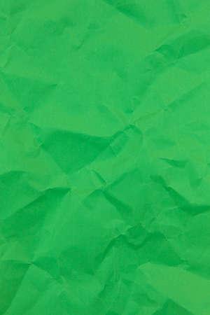 Textured crumpled green paper background. Vertical