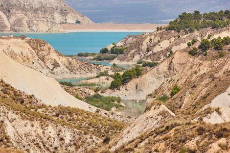 Badlands landscape and blue waters in Algeciras reservoir. Murcia, Spain