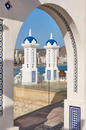 Mediterranean coastline in Benidorm. Castell viewpoint with traditional archs. Alicante
