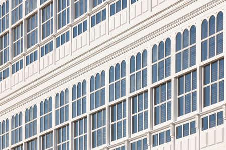 Traditional white balconies glass facades in A Coruna. Galicia, Spain