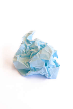 Crumpled blue paper isolated on white. Vertical