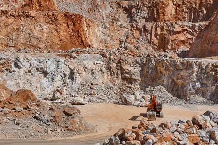 Heavy excavator on a quarry. Excavation machinery. Earthmover Stock Photo