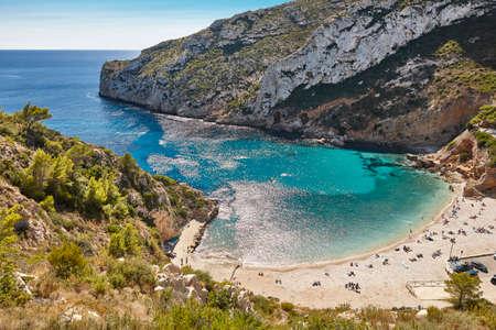 Spanish mediterranean sunny scenic coastline. La Granadella beach. Alicante, Valencia 版權商用圖片
