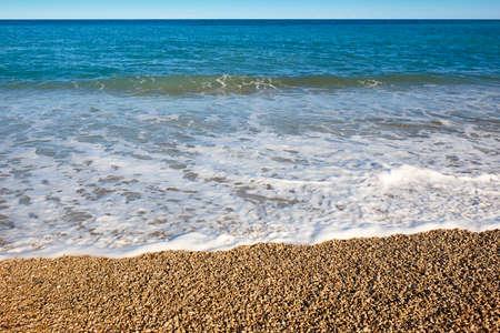Mediterranean pebble beach and blue sea in Valencia. Spain 版權商用圖片