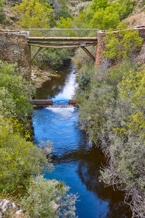 Antique slate stone bridge over Jarama river. Roblelacasa, Guadajara. Spain