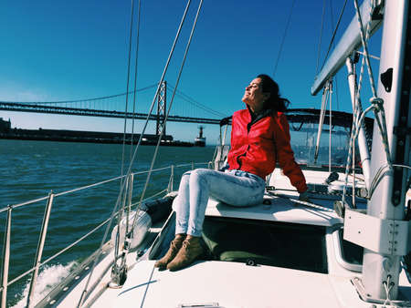 sf: Happy female sailing the SF Bay