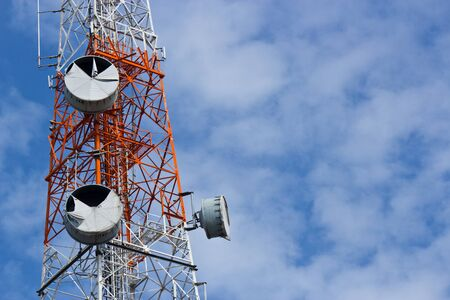 close up telecommunications tower with a blue sky photo