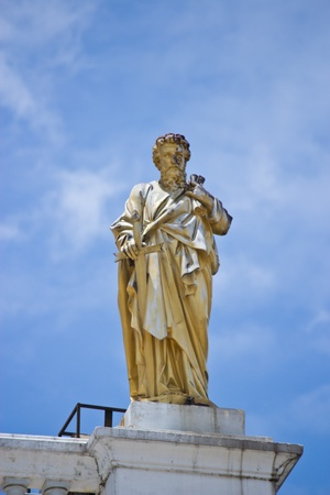 immaculate: golden statue of the saint sky background