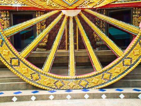 third wheel: Cartwheel statue thai Stock Photo