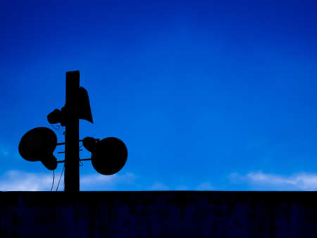 loudspeakers   in blue sky photo