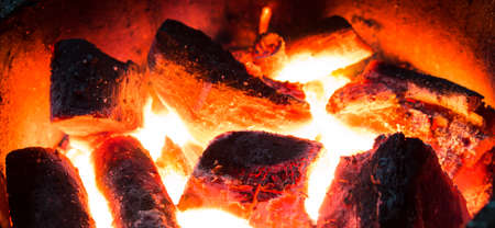 burning charcoal in the background photo
