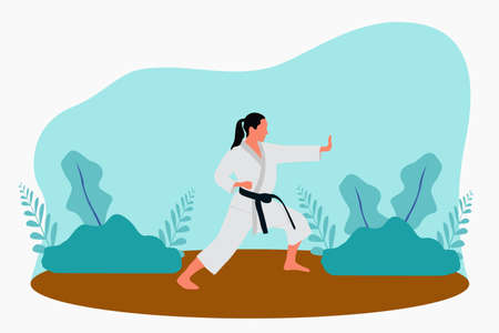 Karate girl training in the nature park