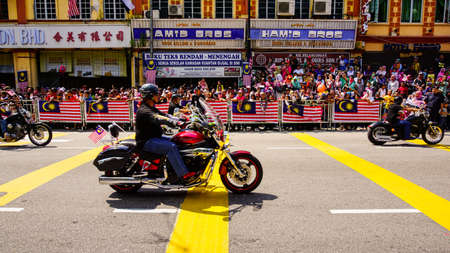 Public peoples watching a convoy of motorcycles club at Malaysia national independance day.