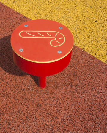 Red stood at public playground photo