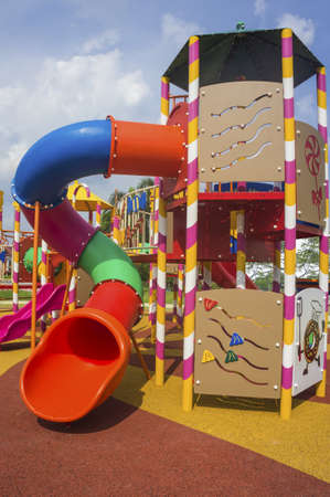 Colorful spiral slide at public playground photo