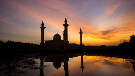 islamic wonderful: The Tengku Ampuan Jemaah Mosque, Bukit Jelutong, Malaysia mosque silhouetted at sunrise