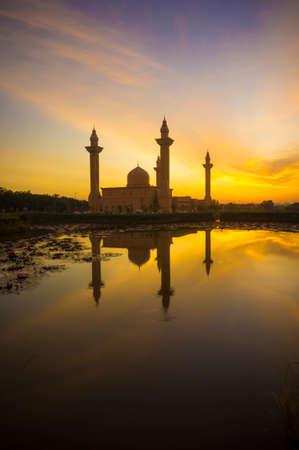 islamic wonderful: Silhouette of the Tengku Ampuan Jemaah Mosque, Bukit Jelutong, Malaysia mosque at sunrise