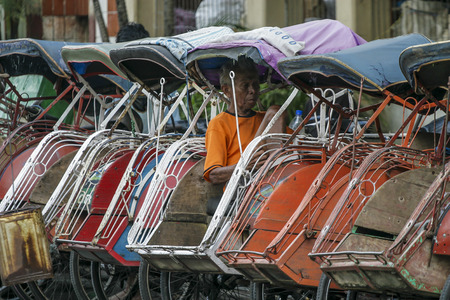 YOGYAKARTA: YOGYAKARTA, INDONESIA - APRIL 29, 2008: Trishaw or Becak at Yogyakarta town. Editorial