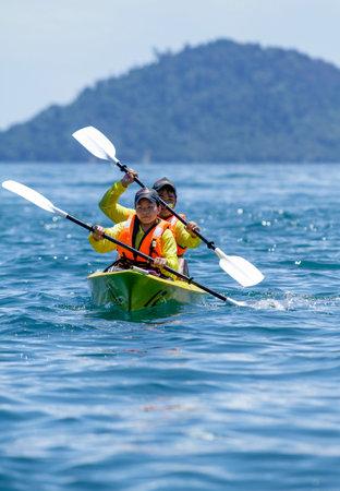 gaya: SABAH, MALAYSIA - MAY 16, 2011: People kayaking on the Gaya Island.