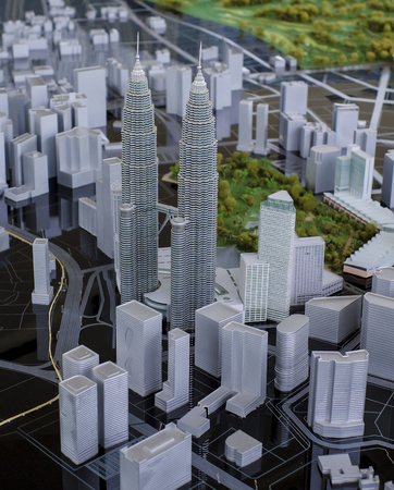 1malaysia: KUALA LUMPUR, MALAYSIA - AUGUST 10, 2016: Scale model of a city showing the Petronas Twin Towers. Petronas Twin Towers also known as KLCC (Kuala Lumpur City Center). Editorial