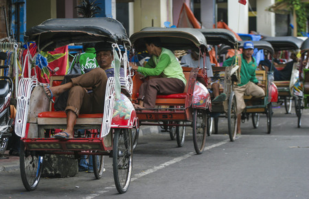 trishaw: YOGYAKARTA, INDONESIA - APRIL 29, 2008: Trishaw or Becak at Yogyakarta town. Editorial