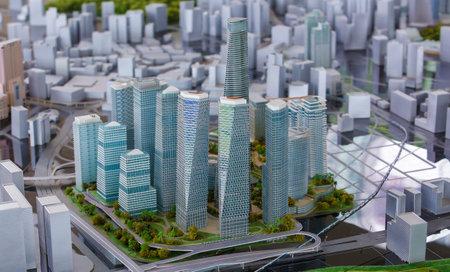 tun: KUALA LUMPUR, MALAYSIA - AUGUST 10, 2016: Scale model of a city showing the project of Tun Razak Exchange (TRX).