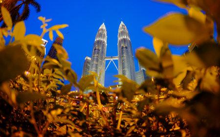 KUALA LUMPUR, MALAYSIA - MAY 25, 2014: Petronas Twin Towers during blue hour sunset. Petronas Twin Towers also known as KLCC (Kuala Lumpur City Centre). Editorial