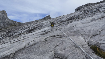 lows: Climbers headed to the Lows Peak (4095m) summit of Mount Kinabalu, Sabah, Malaysia. Mount Kinabalu or Gunung Kinabalu is the 20th most prominent mountain in the world by topographic prominence.