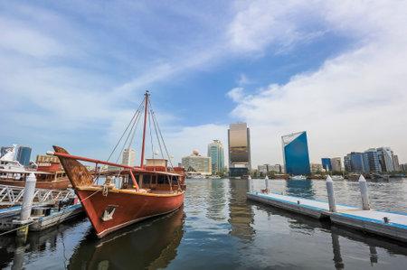 Traditional arabic Dhow at Dubai Creek, United Arab Emirates (UAE). Dubai Creek are one of famous place in Dubai with boat taxi activity.