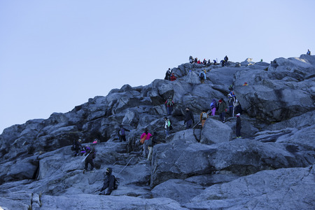 lows: RANAU, MALAYSIA - AUGUST 23, 2014 - Climbers headed to the Lows Peak (4095m) summit of Mount Kinabalu, Sabah, Malaysia. Mount Kinabalu or Gunung Kinabalu is the 20th most prominent mountain in the world by topographic prominence.