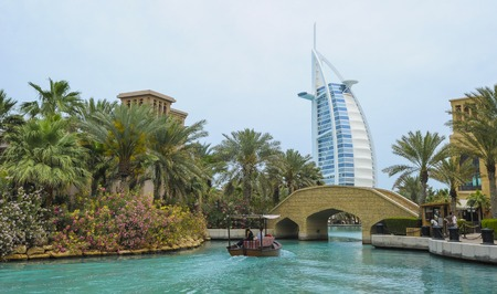 View of Burj Al Arab (Tower of the Arabs) hotel from Madinat Jumeirah hotel, Dubai. Madinat is a luxury resort which includes hotels and souk spreding across over 40 hectars. Editorial