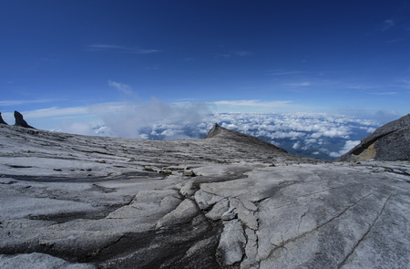 prominence: The beauty of Mount Kinabalu, Sabah, Malaysia, with the view of South Peak (3,921m). Mount Kinabalu or Gunung Kinabalu is the 20th most prominent mountain in the world by topographic prominence.
