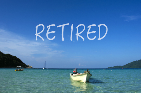 RETIRED word with crystal clear waters beach  island at background.