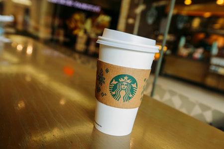 KUALA LUMPUR, MALAYSIA - JULY 04, 2017 : Hot Starbucks coffee in Starbucks Coffee shop. Starbucks Corporation is an American coffee company and coffeehouse chain.