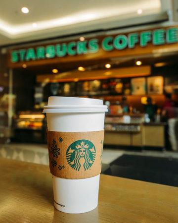 famous industries: KUALA LUMPUR, MALAYSIA - JULY 04, 2017 : Hot Starbucks coffee in Starbucks Coffee shop. Starbucks Corporation is an American coffee company and coffeehouse chain.