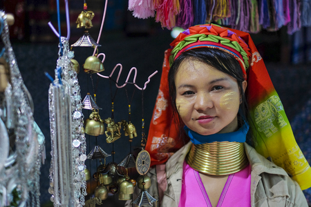 MAE HONG SON, THAILAND - DECEMBER 18, 2015 : Long neck lady from Kayan Lahwi tribe known for wearing neck rings, brass coils to extend the neck at Karen Long Neck Village. Editorial