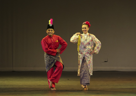 KUALA LUMPUR, MALAYSIA - NOVEMBER 15, 2016 : Man and women performing Malaysia traditional dance during public event.