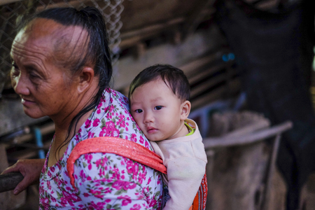 MAE HONG SON, THAILAND - DECEMBER 18, 2015 : Kayan Lahwi tribe at Karen Long Neck Village.