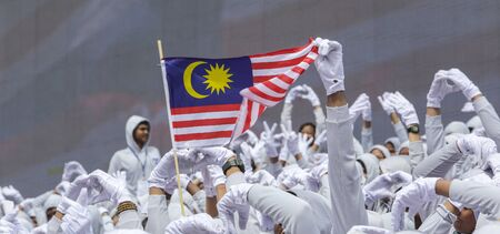 KUALA LUMPUR, MALAYSIA - AUGUST 31, 2016 : Hand waving Malaysia flag also known as Jalur Gemilang. People fly the flag in conjunction with the Independence Day celebration or Merdeka Day on 31 August and Hari Malaysia on 16 September. Redakční
